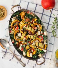 This roasted delicata squash recipe is a delicious vegan side dish. The sweet, creamy squash is tossed with kale, apples, herbs, pepitas, and a bright cider dressing.