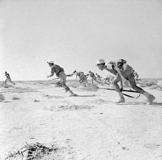 Free French Foreign Legionaires attack Axis positions during the Battle of Bir Hakeim, 1942.