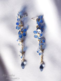 Dangle earrings. Transparent. Forget-me-not. Resin.