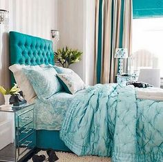 I want this headboard!  Beautiful, and the nightstand and bed linens in the same color family is lovely, too.