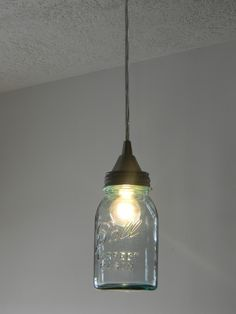5 mason jar lighting ideas: Mason Jar Pendant via @odeleanne