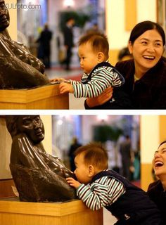 Not shy around strangers - Baby wants to get nursed by a statue