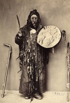 Buryat Kam(Shaman) in ritual costume and with drum.