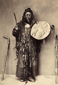 Buryat Kam(Shaman) in ritual costume and with drum.