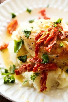 Slow Cooker Creamy Sun Dried Tomato Chicken... A delicious and creamy chicken recipe that is loaded with amazing flavor! The sun dried tomatoes and basil truly make this meal outstanding!