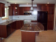 Cherry Kitchen Cabinets Black Granite cherry cabinets and ubatuba (hehehe) granite countertops with
