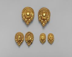 Gold earrings  Period: Late Classical Date: 4th–early 3rd century B.C. Culture: Etruscan Medium: Gold Dimensions: Other (.1): 2 1/8 in. (5.4 cm) Other (.2): 2 in. (5.1 cm) Classification: Gold and Silver