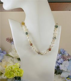 19 white freshwater rice pearls and by DesignsbyDMCandles on Etsy