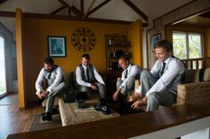 The groom and groomsmen get ready in one of the many amazing beach houses on Straddie  Stradbroke Island Photography