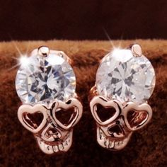 Skull Studs 18k gold plated small skull earrings. So cute! CZ stones! New in package. Jewelry Earrings