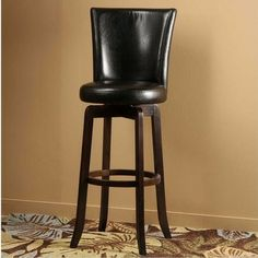 The Copenhagen Stool is a comfortable classic. Made of solid hardwood with a espresso finish, the Copenhagen boasts a full, elegantly arched back and 360 swivel seat both covered in your choice of a black or brown vinyl. The Copenhagen is available in both bar and counter heights. Some assembly...