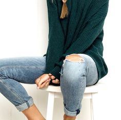 Cozy forest green sweater and worn light rinse skinny jeans