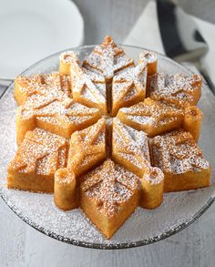 A beautiful almond snowflake cake simply dusted with powdered sugar.