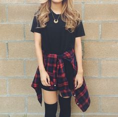Black t-shirt dress along with a plaid button-up wrapped around the waist