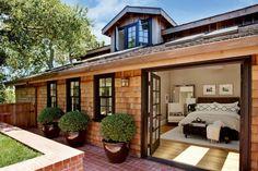 Black framed windows; french doors; natural cedar shakes; skylights