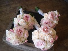 cream 'Vendela' & 'Sweet Avalanche' Roses with pink & cream spray Roses.  Pearls placed randomly amongst the Roses.