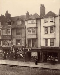 A woman lingers in front of the butcher in Borough High St, Southwark.