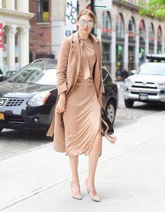 On Hadid: Jonathan Simkhai dress; Topshop coat; Versace bag; Gentle Monster sunglasses.