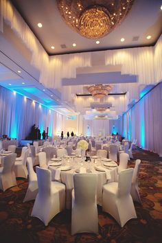 An all-white wedding is a clean, contemporary look when you add up-lighting and sleek, form fitting chair covers. White Chair Covers, Banquet Chair Covers, Wedding Chair Covers, Wedding Reception Chairs, Wedding Ceremony, Wedding Venues, Long Chair, Spandex Chair Covers, Diy Chair