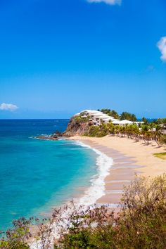 A blue-sky view of the turquoise sea around Curtain Bluff - a luxury, beachside resort in Carlisle Bay on the Caribbean island of Antigua. Photo by Mirjam Bleeker Commonwealth, Beautiful Places To Visit, Places To See, Amazing Places, Beautiful Beaches, Resorts, Caribbean Sea, Antigua Caribbean, Island Resort