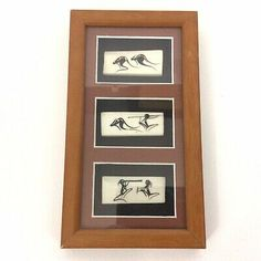 <p>Melaleuca Malie Aboriginal Bone Art Framed Artifact Australia.</p><p>Three pieces of hand painted bone set in a matter frame.</p><p>Scenes show kangaroos and hunters.</p><p>Frame measures 8 1/2 inches x 4 3/4 inches.</p><p>Ready to hang. No damage to the art or frame.</p><p>Please note that the back cardboard was pulled from the staples in one corner. This is easily fixed at home or by a framer.</p><p>Please review all photos.</p> Aboriginal Artists, Framed Art, Wall Art, Photo P, Melaleuca, Rock Art, Hand Painted, Australia, Kangaroos