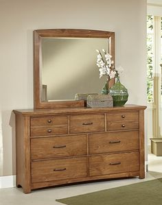 Catalina ll Dresser & Mirror $849.99 Sku:135095 Dimensions:62Wx19Dx76.5H The Catalina is a casual contemporary collection, the dark oak color gives a relaxing feel, and with a complementing upholstered headboard you'll have the perfect, cozy oasis. The Catalina is very aesthetically appealing, but the beautiful collection is one that will last you for years to come, made of solid oak, and has been lightly distressed to add to the beauty. Please visit our website for warranty and benefits.