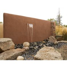 Sheet waterfall in wall. Water disappears into an underground basin. Design: Clemens & Associates. Photo: Lee Anne White