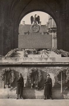 """This is a Nazi memorial cenotaph on the east side of the Munich Feldherrnhalle on the Odeonsplatz to the fallen in the November 9, 1923 """"Beer-Hall Putsch"""", an unsuccessful revolutionary coup attempt led by Adolf Hitler, via Jedem das seine. It was toppled by American soldiers in June 1945 and melted for scrap."""