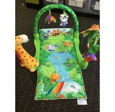 Fisher Price 1-2-3 Musical Gym - Fisher Price 1-2-3 Musical Gym offers plenty of music, sounds and other stimulating features to keep your baby entertained for hours.  Click the link below to see more of the great merchandise available at Lily Pads! - $18.00