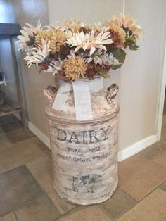 vintage milk can with fall flowers - at Just Add Some Java blogspot