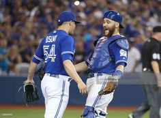 Russell Martin of the Toronto Blue Jays celebrates their victory with Roberto Osuna during MLB game action against the Houston Astros on August 2016 at Rogers Centre in Toronto, Ontario, Canada. Russell Martin, Famous Sports, Sports Celebrities, Hockey, Baseball, Mlb Teams, American League, Toronto Blue Jays, Go Blue