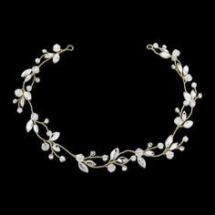 Chic and elegant crystal hair vine - with freshwater pearls and high quality cz crystals on a gold tone finish.