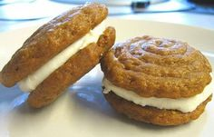 Pumpkin whoopie pies with cream cheese filling.  These look amazing!