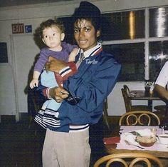 Michael Jackson, not sure who the little boy is, i'm assuming a fan lol.