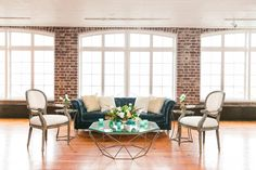 Lounge Featuring Navy Tufted Sofa + Gold Coffee Table | Classic Southern Wedding at the Rice Mill | Dana Cubbage Weddings, Charleston SC Wedding Photography