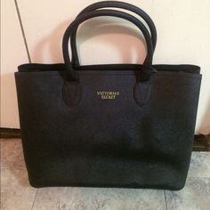 Victoria's Secret Handbag Black handbag split into two sides by zipper compartment. Zipper handle is missing but can easily be replaced with whatever pull you choose. Victoria's Secret Bags Totes