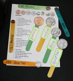 I love this idea from Classroom Freebies: Coin Popsicle Sticks