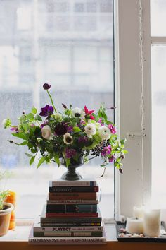 flowers and books | via Ruffled, shoot from Sweet Woodruff and Vicky Starz Photography