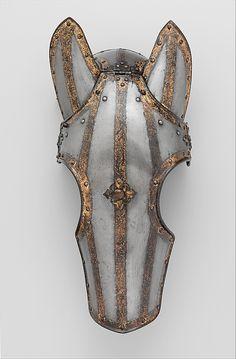 Shaffron (Horse's Head Defense) Date: ca. 1620 Culture: Dutch Medium: Steel, gold, leather Dimensions: 21 1/4 x 10 1/4 in. (54 x 26 cm), wt. 4 lb. 5 oz. (1949 g) Classification: Equestrian Equipment Credit Line: Rogers Fund, 1904 Accession Number: 04.3.109