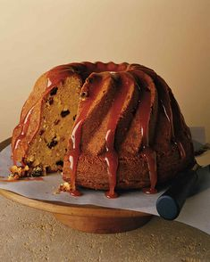Dark rum is lavishly used in a coconut Bundt cake; raisins, plump from soaking in the liquor, are mixed into the batter, and a sweet sticky glaze is drizzled on top. Martha Stewart, Rum And Raisin Cake, Cake Recipes, Dessert Recipes, Pudding Recipes, Baking Recipes, Coconut Pecan, Chocolate Bundt Cake, Rum Cake