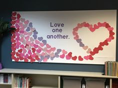 """Love one another"". Our February 2018 St. Stephen Catholic Community Teacher Resource Room bulletin board."