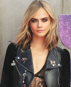 Cara Delevingne's smoky eye makeup, cute lob haircut and embellished Alexander…