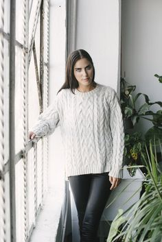 Gray Hand-Knit Cable Sweater with black leather leggings.