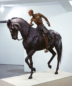 Real horse and man become art.