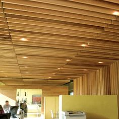 Acoustic suspended ceiling / wood / strip / curved LINEAR: GRID Hunter Douglas