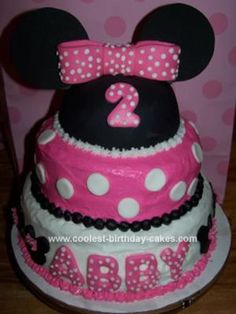 Looking for ideas for a Minnie Mouse birthday cake... I like this one because the cake isn't covered with fondant.