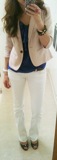Tan blazer, white pants and a navy blue blouse, topped off with black high heels