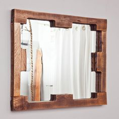 Pallet wood frame pieces roughly sanded, stained & polished make this cool frame for a dollar store, El cheapo shop mirror. Plain & simple, love it ; Pallet Mirror Frame, Wood Framed Mirror, Diy Mirror, Rustic Mirrors, Rustic Lamps, Mirror Ideas, Pallet Crates, Wood Pallets, Pallet Wood