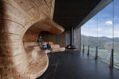 """The Tverrfjellhytta Pavillion, Dovre Mountains, Norway. Commissioned by the Norwegian Wild Reindeer Centre and designed by Snøhetta in Oslo this visitor observation area is stunningly beautiful.  The 10"""" square pine beams have been sculpted into an undulating structure refelcting the surrounding landscape"""