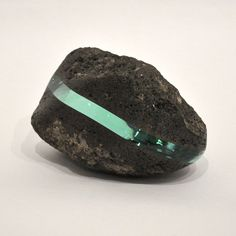 title: o.T. - Jawa#04 / size: 140x185x120mm / medium: Volcanic rock from JAVA island, glass